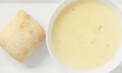 Bowl of creamy parsnip soup with crusty bread